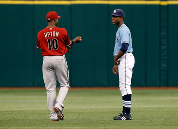 ST. PETERSBURG - JUNE 27:  B.J. Upton #2 of the Tampa Bay Rays talks with his brother Justin Upton #10 of the Arizona Diamondbacks just prior to the start of the game at Tropicana Field on June 27, 2010 in St. Petersburg, Florida.  (Photo by J. Meric/Gett