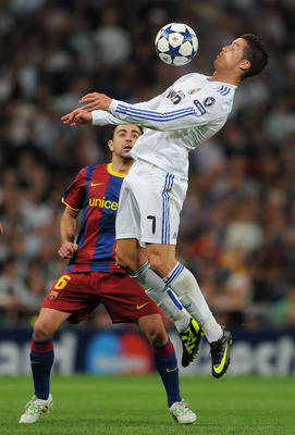MADRID, SPAIN - APRIL 27:  Cristiano Ronaldo (R) of Real Madrid duels for the ball with Xavi Hernandez of Barcelona during the UEFA Champions League Semi Final first leg match between Real Madrid and Barcelona at the Estadio Santiago Bernabeu on April 27,