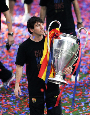 BARCELONA, SPAIN - MAY 29:  Lionel Messi of FC Barcelona holds the UEFA Champions League Trophy during the celebrations after winning the UEFA Champions League Final against Manchester United, at Camp Nou Stadium on May 29, 2011 in Barcelona, Spain.  (Pho