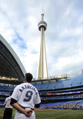 TORONTO, CANADA - JULY 26:  J.P. Arencibia #9 of the Toronto Blue Jays looks on during the national anthems prior to MLB game action against the Baltimore Orioles July 26, 2011 at Rogers Centre in Toronto, Ontario, Canada. (Photo by Brad White/Getty Image