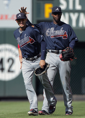 DENVER, CO - JULY 21:  (L-R) Outfielders Jordan Schafer #1 and Jason Heyward #22 of the Atlanta Braves celebrate the Braves 9-6 win over the Colorado Rockies at Coors Field on July 21, 2011 in Denver, Colorado.  (Photo by Doug Pensinger/Getty Images)