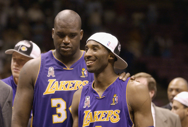 EAST RUTHERFORD, NJ - JUNE 12: Kobe Bryant #8 and Shaquille O'Neal #34 of the Los Angeles Lakers celebrate after defeating the New Jersey Nets in Game four of the 2002 NBA Finals at Continental Airlines Arena in East Rutherford, New Jersey on June 12, 200