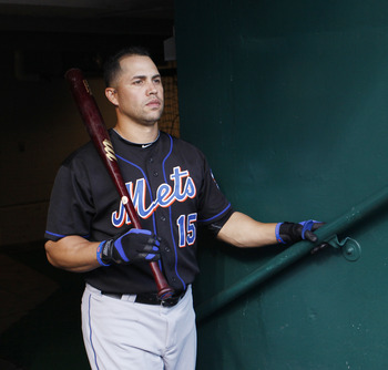 CINCINNATI, OH - JULY 26: Carlos Beltran #15 of the New York Mets looks on before the game against the Cincinnati Reds at Great American Ball Park on July 26, 2011 in Cincinnati, Ohio. (Photo by Joe Robbins/Getty Images)