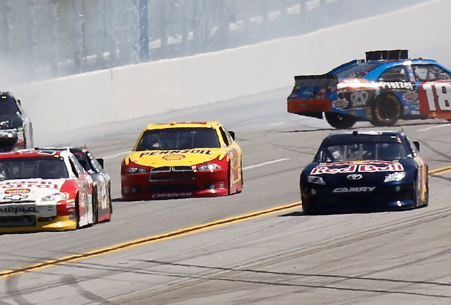 TALLADEGA, AL - APRIL 17:  Kyle Busch, driver of the #18 M&M's Pretzel Toyota, and Matt Kenseth, driver of the #17 Crown Royal Black Ford, spin out after an incident in the NASCAR Sprint Cup Series Aaron's 499 at Talladega Superspeedway on April 17, 2011