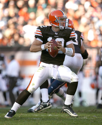 CLEVELAND - NOVEMBER 07:  Quarterback Colt McCoy #12 of the Cleveland Browns throws to a receiver against the New England Patriots at Cleveland Browns Stadium on November 7, 2010 in Cleveland, Ohio.  (Photo by Matt Sullivan/Getty Images)