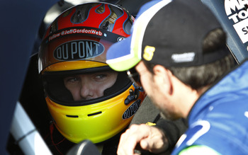 CHARLOTTE, NC - MAY 20:  Jimmie Johnson (R) , driver of the #5 Lowe's 5% Every Day Chevrolet, talks to Jeff Gordon (L), driver of the #24 DuPont Chevrolet, on the grid during qualifying for the NASCAR Sprint All-Star Race at Charlotte Motor Speedway on Ma
