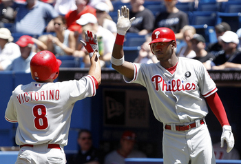 TORONTO, CANADA - JULY 3: Shane Victorino #8 and Domonic Brown #9 of the Philadelphia Phillies celebrate 2-run RBI by Jimmy Rollins against the Toronto Blue Jays during MLB action at The Rogers Centre July 3, 2011 in Toronto, Ontario, Canada. (Photo by Ab
