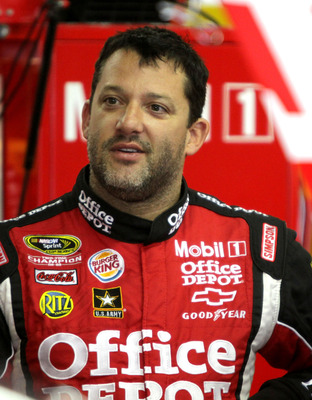 LOUDON, NH - JULY 16:  Tony Stewart, driver of the #14 Office Depot/Mobil 1 Chevrolet, stands in the garage during practice for the NASCAR Sprint Cup Series LENOX Industrial Tools 301 at New Hampshire Motor Speedway on July 16, 2011 in Loudon, New Hampshi
