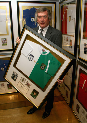 LONDON - NOVEMBER 12:  Former professional footballer Pat Jennings poses in front of his framed, signed shirt that will be auctioned for charity in Harrods on November 12, 2007 in London, England. The shirt is one of 34 signed by winners of the PFA Player