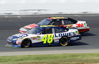 LOUDON, NH - JULY 17:  Jimmie Johnson, driver of the #48 Lowe's Chevrolet, and Greg Biffle, driver of the #16 3M Ford, fight for position in turn four during the NASCAR Sprint Cup Series LENOX Industrial Tools 301 at New Hampshire Motor Speedway on July 1