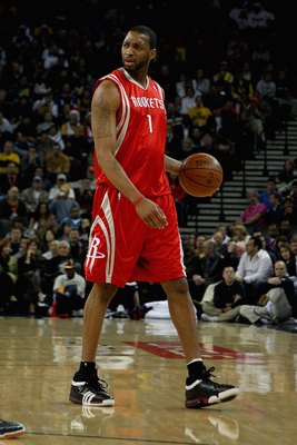 OAKLAND, CA - DECEMBER 12:  Tracy McGrady #1 of the Houston Rockets moves the ball across the court during the game against the Golden State Warriors on December 12, 2008 at Oracle Arena in Oakland, California.  The Rockets won 119-108.  NOTE TO USER: Use