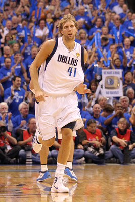 DALLAS, TX - JUNE 07:  Dirk Nowitzki #41 of the Dallas Mavericks runs back on defense against the Miami Heat in Game Four of the 2011 NBA Finals at American Airlines Center on June 7, 2011 in Dallas, Texas. NOTE TO USER: User expressly acknowledges and ag