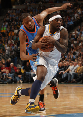 DENVER, CO - APRIL 25:  Ty Lawson #3 of the Denver Nuggets drives past Kevin Durant #35 of the Oklahoma City Thunder during the second quarter in Game Four of the Western Conference Quarterfinals in the 2011 NBA Playoffs at Pepsi Center on April 25, 2011