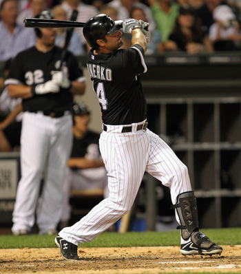 CHICAGO, IL - JULY 26: Paul Konerko #14 of the Chicago White Sox hits a game-tying, two-run home run in the 6th inning against the Detroit Tigers at U.S. Cellular Field on July 26, 2011 in Chicago, Illinois. (Photo by Jonathan Daniel/Getty Images)