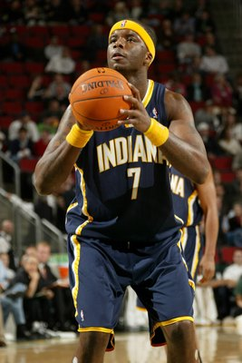 SEATTLE - DECEMBER 1:  Jermaine O'Neal #7 of the Indiana Pacers shoots a free throw against the Seattle Sonics on December 1, 2006 at Key Arena in Seattle, Washington. The Sonics won 105-103. NOTE TO USER: User expressly acknowledges and agrees that, by d