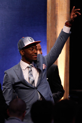 NEWARK, NJ - JUNE 23:  Kemba Walker from UCONN celebrates after he was selected #9 overall by the Charlotte Bobcats in the first round during the 2011 NBA Draft at the Prudential Center on June 23, 2011 in Newark, New Jersey.  NOTE TO USER: User expressly