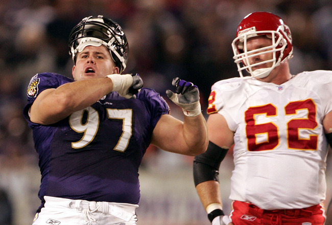 BALTIMORE - OCTOBER 4:  Kelly Gregg #97 of the Baltimore Ravens celebrates after tackling Priest Holmes of the Kansas City Chiefs while Casey Wiegmann #62 looks on, on October 4, 2004 at M&T Bank Stadium in Baltimore, Maryland.  (Photo by Doug Pensinger/G