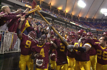 24 Nov 2001:  Minnesota players run around the field after they beat Wisconsin 42-31 to reclaim Paul Bunyan's Axe at the Hubert H. Humphrey Metrodome in Minneapolis, Minnesota. Paul Bunyan's Axe has been the symbol of the rivalry between the two teams sin