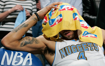 DENVER, CO - APRIL 23:  Kenyon Martin #4 of the Denver Nuggets sits frustrated on the sidelines during a 97-94 loss to the Oklahoma City Thunder in Game Three of the Western Conference Quarterfinals in the 2011 NBA Playoffs at Pepsi Center on April 23, 20