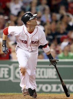 BOSTON, MA - JULY 26:  Dustin Pedroia #15 of the Boston Red Sox gets a hit against the Kansas City Royals on July 26, 2011 at Fenway Park in Boston, Massachusetts.  (Photo by Elsa/Getty Images)