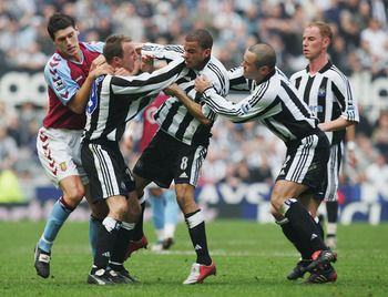 Lee Bowyer, second from left, thugging it with teammate Dyer.