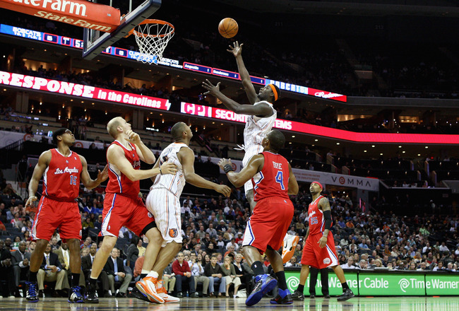 CHARLOTTE, NC - MARCH 07:  The Los Angeles Clippers watch as Kwame Brown #54 of the Charlotte Bobcats takes a shot during their game at Time Warner Cable Arena on March 7, 2011 in Charlotte, North Carolina. NOTE TO USER: User expressly acknowledges and ag
