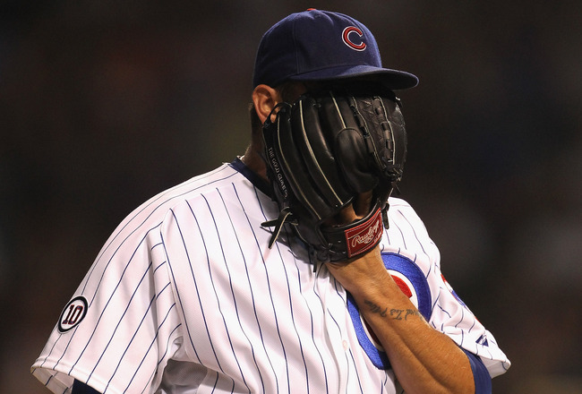 CHICAGO, IL - JULY 19:  Starting pitcher Matt Garza #17 of the Chicago Cubs yells into his glove after being taken out of a game against the Philadelphia Phillies at Wrigley Field on July 19, 2011 in Chicago, Illlinois.  (Photo by Jonathan Daniel/Getty Im