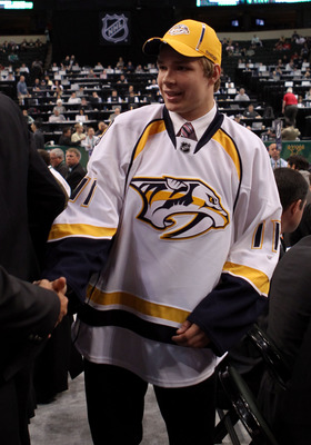 ST PAUL, MN - JUNE 25:  52nd overall pick Miikka Salomaki by the Nashville Predators is greeted by a member of the Nashville Predators organization during day two of the 2011 NHL Entry Draft at Xcel Energy Center on June 25, 2011 in St Paul, Minnesota.  (