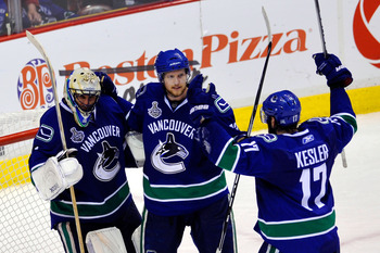 VANCOUVER, BC - JUNE 10:  Roberto Luongo #1, Alexander Edler #23 and Ryan Kesler #17 of the Vancouver Canucks celebrate after defeating the Boston Bruins by a score of 1-0 in Game Five of the 2011 NHL Stanley Cup Final at Rogers Arena on June 10, 2011 in