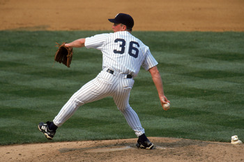 BRONX, NY - JULY 18:  David Cone #36 of the New York Yankees winds up for a pitch during a game against the Montreal Expos at Yankee Stadium on July 18, 1999 in the Bronx, New York.  David Cone threw for a perfect game as the Yankees defeated the Expos wo