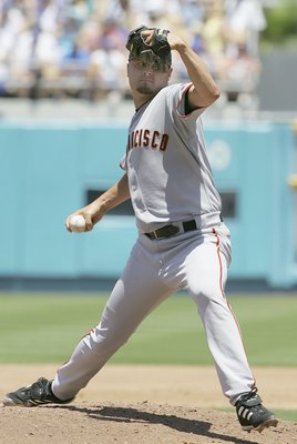 LOS ANGELES - JULY 9:  Jason Schmidt #29 of the San Francisco Giants pitches in the third inning against the Los Angeles Dodgers on July 9, 2006 at Dodger Stadium in Los Angeles, California. The Dodgers won 3-1.  (Photo by Lisa Blumenfeld/Getty Images)
