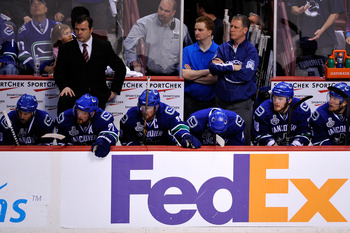 VANCOUVER, BC - JUNE 15:  Head coach Alain Vigneault (Top Left) of the Vancouver Canucks looks on from the bench against the Boston Bruins during Game Seven of the 2011 NHL Stanley Cup Final at Rogers Arena on June 15, 2011 in Vancouver, British Columbia,