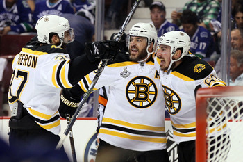 VANCOUVER, BC - JUNE 15:  Patricne Bergeron #37, Mark Recchi #28 and Brad Marchand #63 of the Boston Bruins celebrate after an open goal scored in the third period against Roberto Luongo #1 of the Vancouver Canucks during Game Seven of the 2011 NHL Stanle