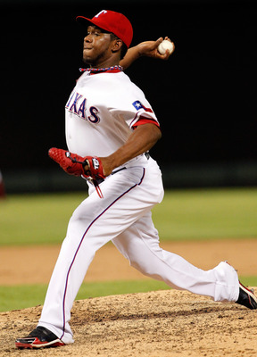 ARLINGTON, TX - JULY 25:  Neftali Feliz #30 of the Texas Rangers pitches against the Minnesota Twins at Rangers Ballpark in Arlington on July 25, 2011 in Arlington, Texas. The Texas Rangers beat the Minnesota Twins 20-6. (Photo by Tom Pennington/Getty Ima