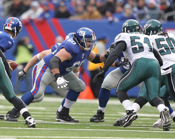 EAST RUTHERFORD, NJ - DECEMBER 19:  Shaun O'Hara #60 of the New York Giants in action against the Philadelphia Eagles during their game on December 19, 2010 at The New Meadowlands Stadium in East Rutherford, New Jersey.  (Photo by Al Bello/Getty Images)