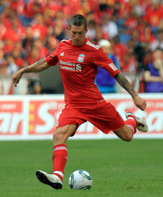 KUALA LUMPUR, MALAYSIA - JULY 16:  Daniel Agger of Liverpool in action during the pre-season friendly match between Malaysia and Liverpool at the Bukit Jalil National Stadium on July 16, 2011 in Kuala Lumpur, Malaysia. (Photo by Stanley Chou/Getty Images)
