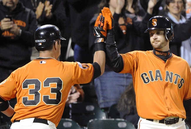 SAN FRANCISCO, CA - JULY 22: Aaron Rowand #33 of the San Francisco Giants celebrates with Jeff Keppinger #8 after hitting a solo against the Milwaukee Brewers in the sixth inning during an MLB baseball game at AT&T Park July 22, 2011 in San Francisco, Cal