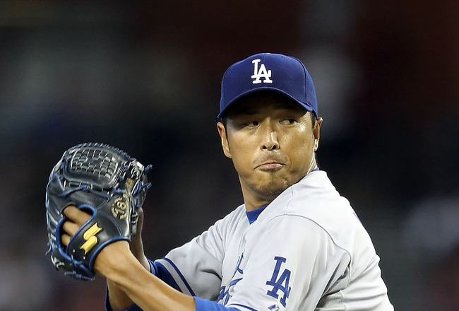 PHOENIX, AZ - JULY 16:  Starting pitcher Hiroki Kuroda #18 of the Los Angeles Dodgers pitches against the Arizona Diamondbacks during the Major League Baseball game at Chase Field on July 16, 2011 in Phoenix, Arizona. The Diamondbacks defeated the Dodgers