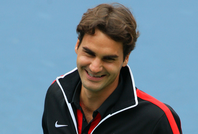 FLUSHING, NY - AUGUST 29:  Roger Federer of Switzerland smiles during Arthur Ashe Kid's Day at the 2009 U.S. Open at the Billie Jean King National Tennis Center on August 29, 2009 in the Flushing neighborhood of the Queens borough of New York City.  (Phot