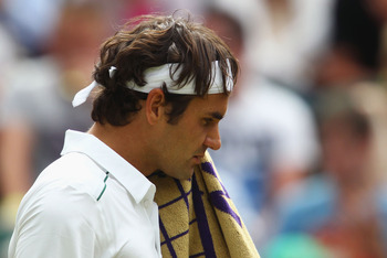 LONDON, ENGLAND - JUNE 29:  Roger Federer of Switzerland looks dejected during his quarterfinal round match against Jo-Wilfried Tsonga of France on Day Nine of the Wimbledon Lawn Tennis Championships at the All England Lawn Tennis and Croquet Club on June