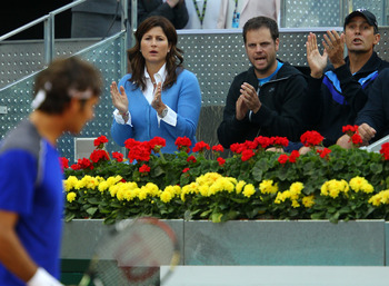 MADRID, SPAIN - MAY 04:  Mirka Federer and Paul Annacone support Roger Federer of Switzerland after the first set tie break in his match against Feliciano Lopez of Spain during day five of the Mutua Madrilena Madrid Open Tennis on May 4, 2011 in Madrid, S
