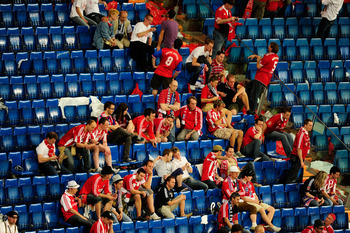 MADRID, SPAIN - MAY 22: Bayern Muenchen fans look dejected after their team's defeat at the end of the UEFA Champions League Final match between FC Bayern Muenchen and Inter Milan at the Estadio Santiago Bernabeu on May 22, 2010 in Madrid, Spain.  (Photo
