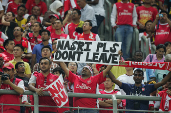 KUALA LUMPUR, MALAYSIA - JULY 13: Arsenal fans during the pre-season Asian Tour friendly match between Malaysia and Arsenal at Bukit Jalil National Stadium on July 13, 2011 in Kuala Lumpur, Malaysia.  (Photo by Stanley Chou/Getty Images)