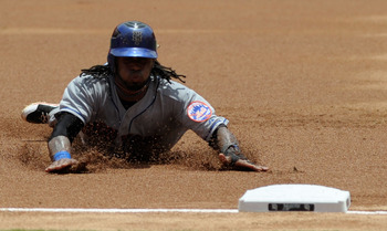 MIAMI GARDENS, FL - JULY 24:  Jose Reyes #7 of the New York Mets slides safely into third base during a game against the Florida Marlins at Sun Life Stadium on July 24, 2011 in Miami Gardens, Florida.  (Photo by Sarah Glenn/Getty Images)