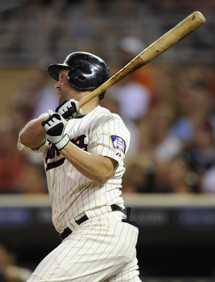 MINNEAPOLIS, MN - JULY 21: Michael Cuddyer #5 of the Minnesota Twins hits an RBI single against the Detroit Tigers in the sixth inning on July 21, 2011 at Target Field in Minneapolis, Minnesota. The Tigers defeated the Twins 6-2. (Photo by Hannah Foslien/