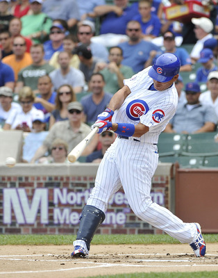 CHICAGO, IL - JULY 22:  Kosuke Fukudome #1 of the Chicago Cubs connects on a single during the first inning against the Houston Astros at Wrigley Field on July 22, 2011 in Chicago, Illinois. The Cubs won 4-2.  (Photo by Brian Kersey/Getty Images)