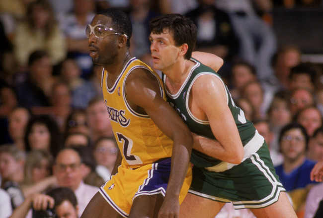 LOS ANGELES - 1987:  James Worthy #42 of the Los Angeles Lakers posts up Kevin McHale #32 of the Boston Celtics during an NBA game at the Great Western Forum in Los Angeles, California in 1987. (Photo by: Rick Stewart/Getty Images)