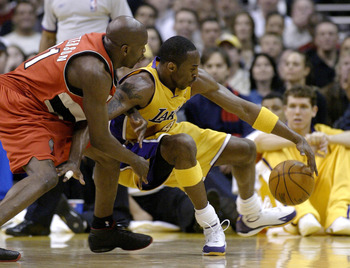 LOS ANGELES - FEBRUARY 17:  Ruben Patterson  #21 of the Portland Trail Blazers puts the pressure on Kobe Bryant #8 of the Los Angeles Lakers on February 17, 2004 at Staples Center  in Los Angeles, California.  NOTE TO USER: User expressly acknowledges and