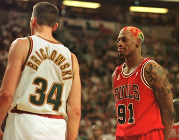 9 Jun 1996:  Dennis Rodman #91 of the Chicago Bulls stares down Frank Brickowski of the Seattle Supersonics after an incident during the fourth quarter shortly before Brickowski was ejected. The Bulls won the third game of the NBA Finals 108-86 over the
