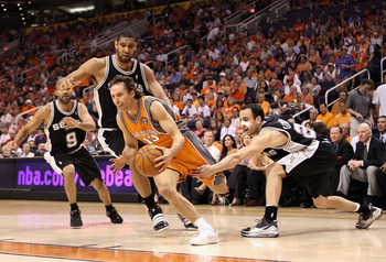 PHOENIX - MAY 05:  Steve Nash #13 of the Phoenix Suns drives the ball past Tony Parker #9, Tim Duncan #21 and Manu Ginobili #20 of the San Antonio Spurs during Game Two of the Western Conference Semifinals of the 2010 NBA Playoffs at US Airways Center on